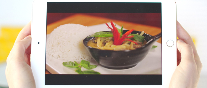 hands-holding-ipad-green-curry-homepage